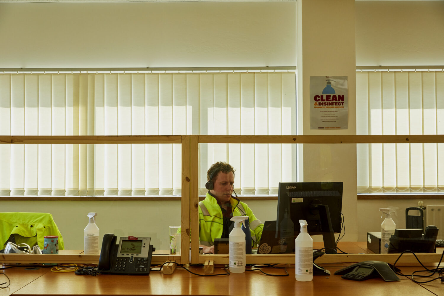 Staff work at pre-booked desks at the AB-Inbev Magor site where workspaces have been adapted to prevent the spread of Covid-19. Perspex screens and sanitizer are available throughout the offices and people wear masks whenever not seated. AB-Inbev Magor, Wales, United Kingdom, June 2021. CREDIT: Emli Bendixen for The Wall Street Journal - Budweiser Brewing Group - Emli Bendixen
