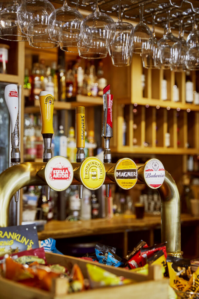Some of AB InBev's products are on offer in the local village pub The Golden Lion in Magor, Wales. CREDIT: Emli Bendixen for The Wall Street Journal - Budweiser Brewing Group - Emli Bendixen