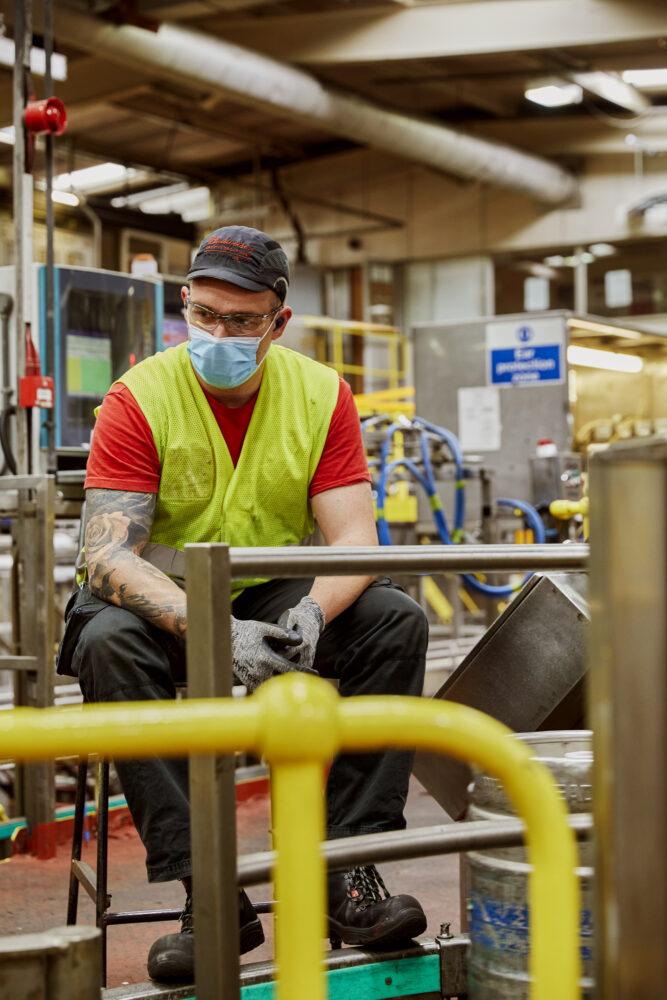 Jamie Boycott checks the kegs at the kegging hall at AB-Inbev Magor in Wales, United Kingdom, June 2021. CREDIT: Emli Bendixen for The Wall Street Journal - Budweiser Brewing Group - Emli Bendixen